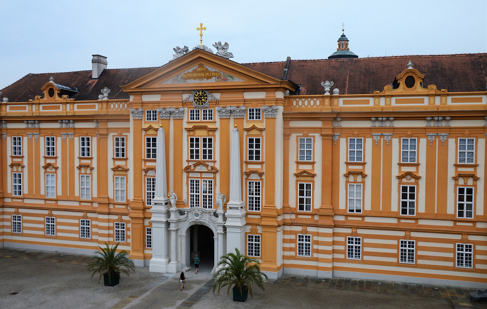 Gold colored main building of Melk Abbey in Austria