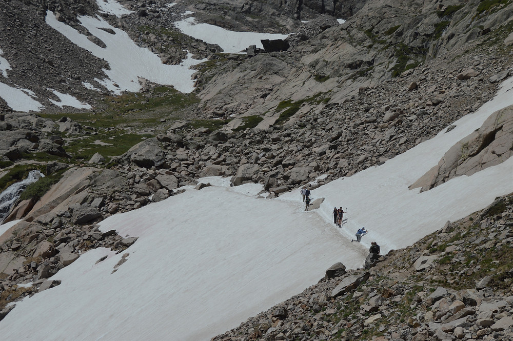Crossing a snowfield on hike to Chasm Lake in Rocky Mountain National Park
