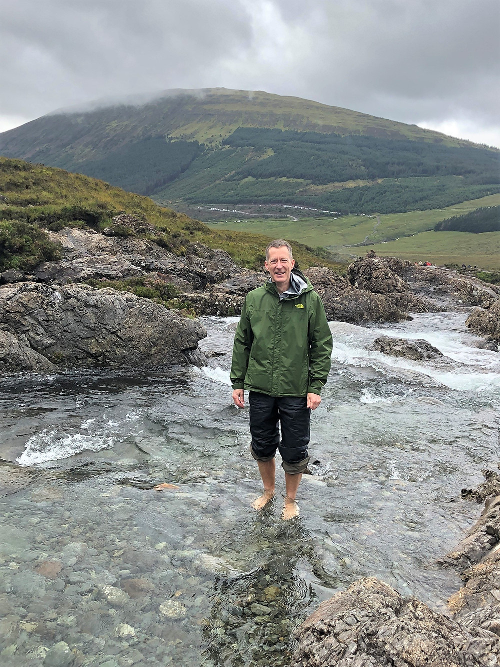 Standing in the waters of Fairy Pool on the Isle of Skye