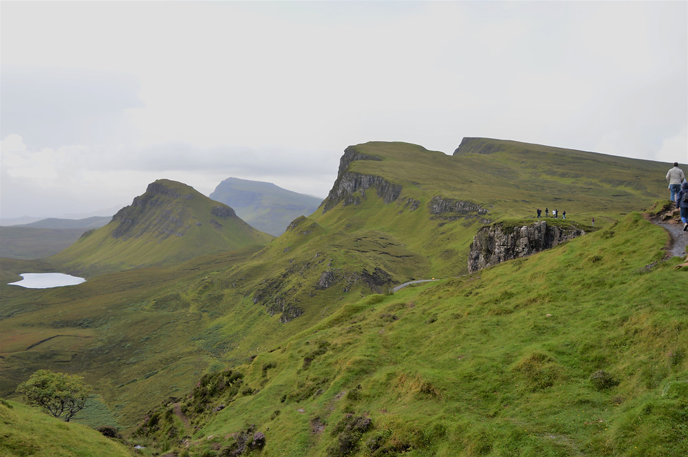 The craggy landscape of Quiraing is covered in moss and grass.  Isle of Skye