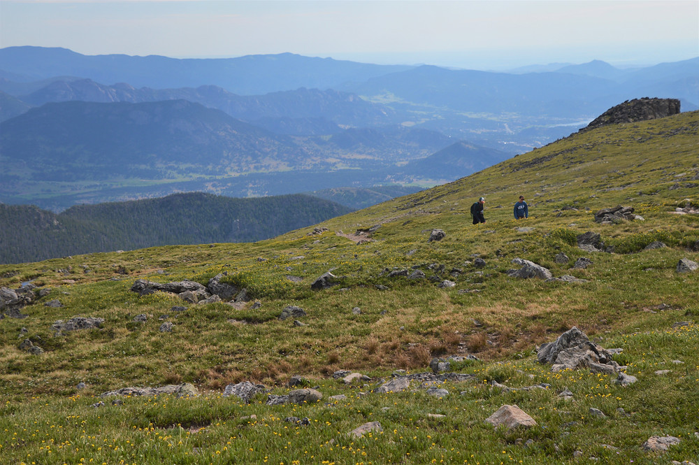 Hiking the exposed alpine tundra plateau on the trail leading to Flattop Mountain in Rocky Mountain National Park