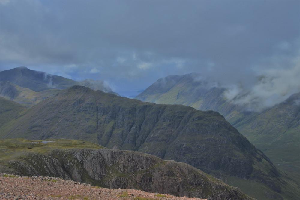 Stob Coire Raineach and Stob Dubh both part of the Buachaille Etive Beag ridge across the glen from near the summit of Stob dearg on Buachaille Etive Mòr