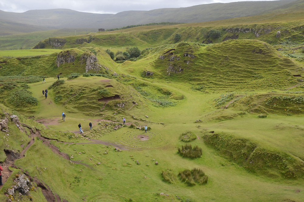 Cone-shaped hills that look like a scaled back version of Quiraing in Fairy Glen on the Isle of Skye
