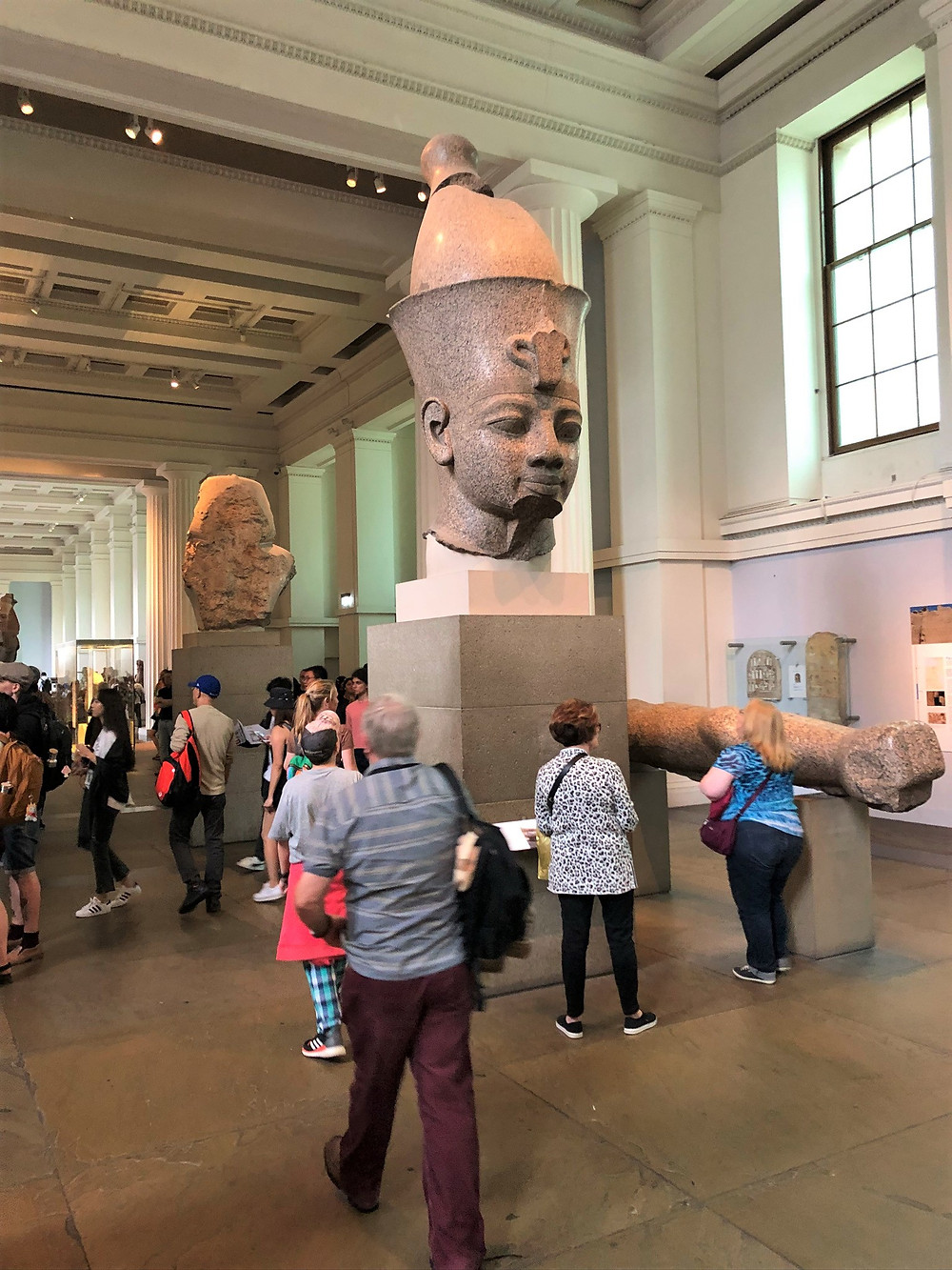 The colossal red granite statue of Amenhotep III in the British Museum in London.  9 feet tall weighing 14500 pounds