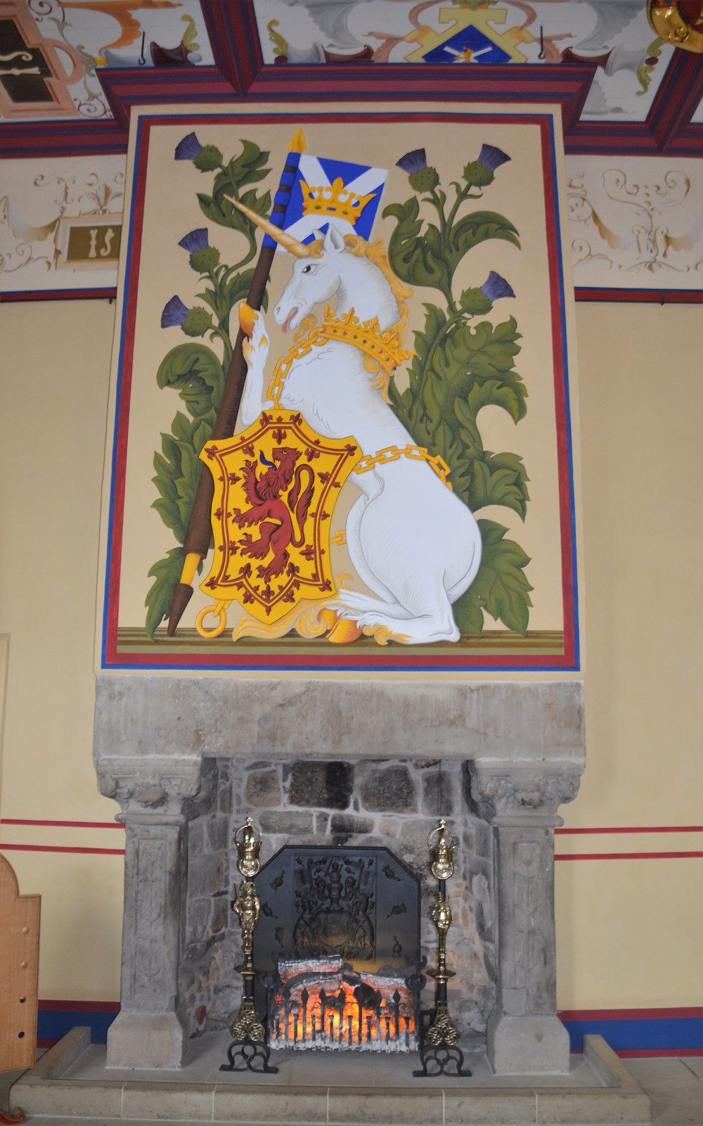 Hanging over fireplace in Scotland.  The unicorn is Scotland's national animal is bound in golden chains