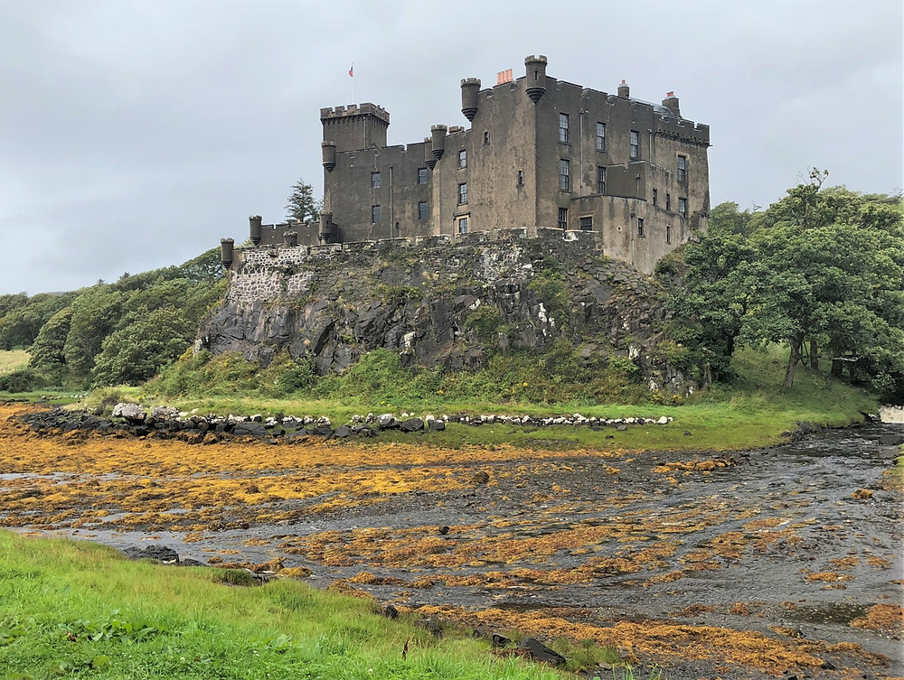 Dunvegan Castle constructed during the early 13th century on top of a basalt outcropping overlooking a harbor of Loch Dunvega