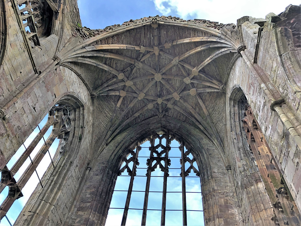 Intricate stone vaulted roof of Melrose Abbey in the Border Region of Southern Scotland. Border abbey.