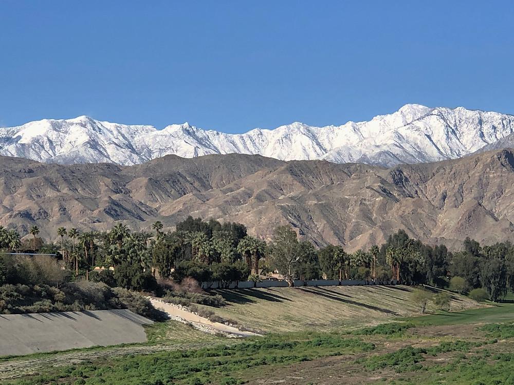Snow-covered San Jacinto mountains surrounding Palm Desert