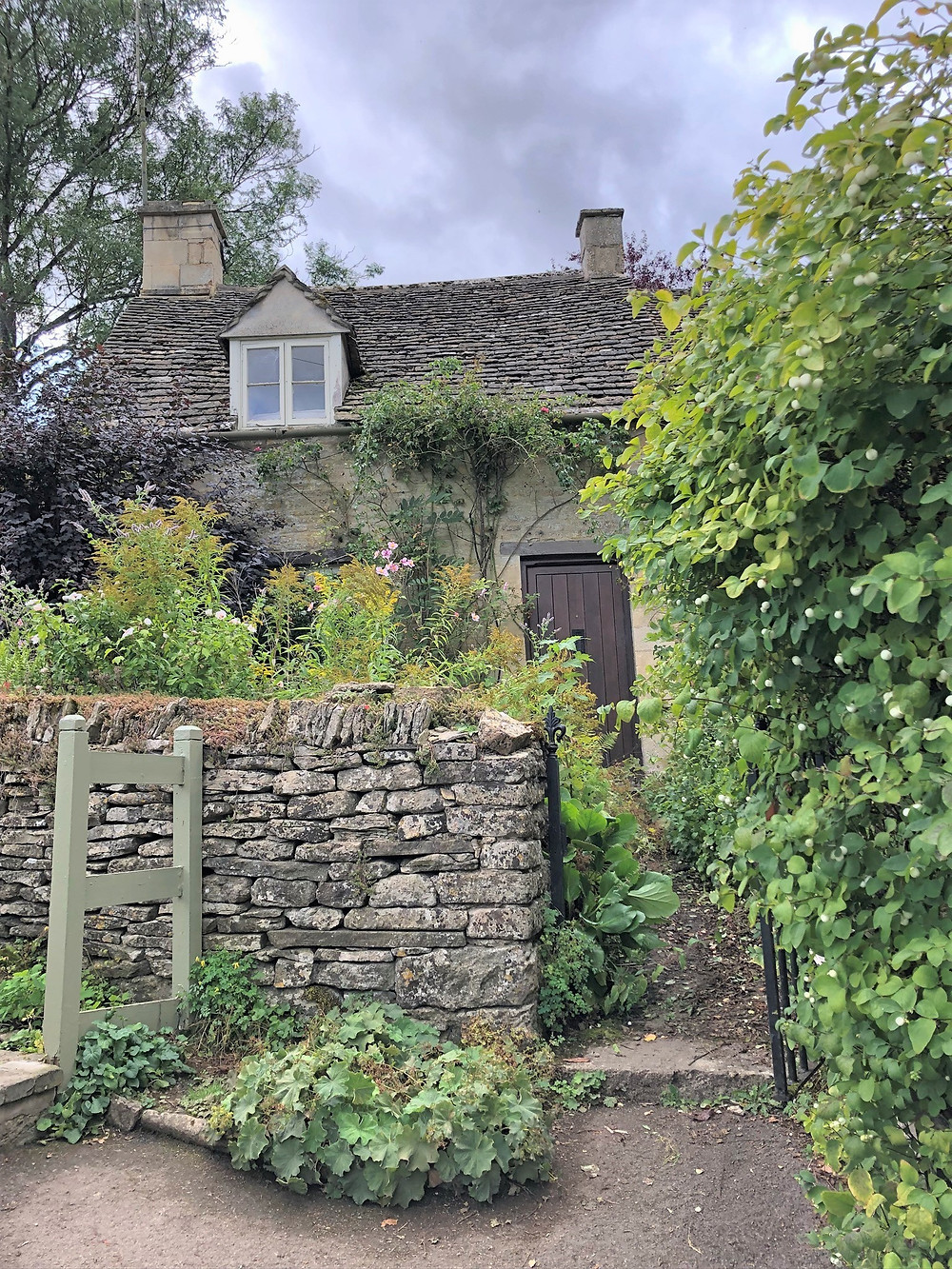 Arlington Row homes in Bibury of the Cotswolds. 17th century row of weavers' cottages in Bibury of the Cotswolds