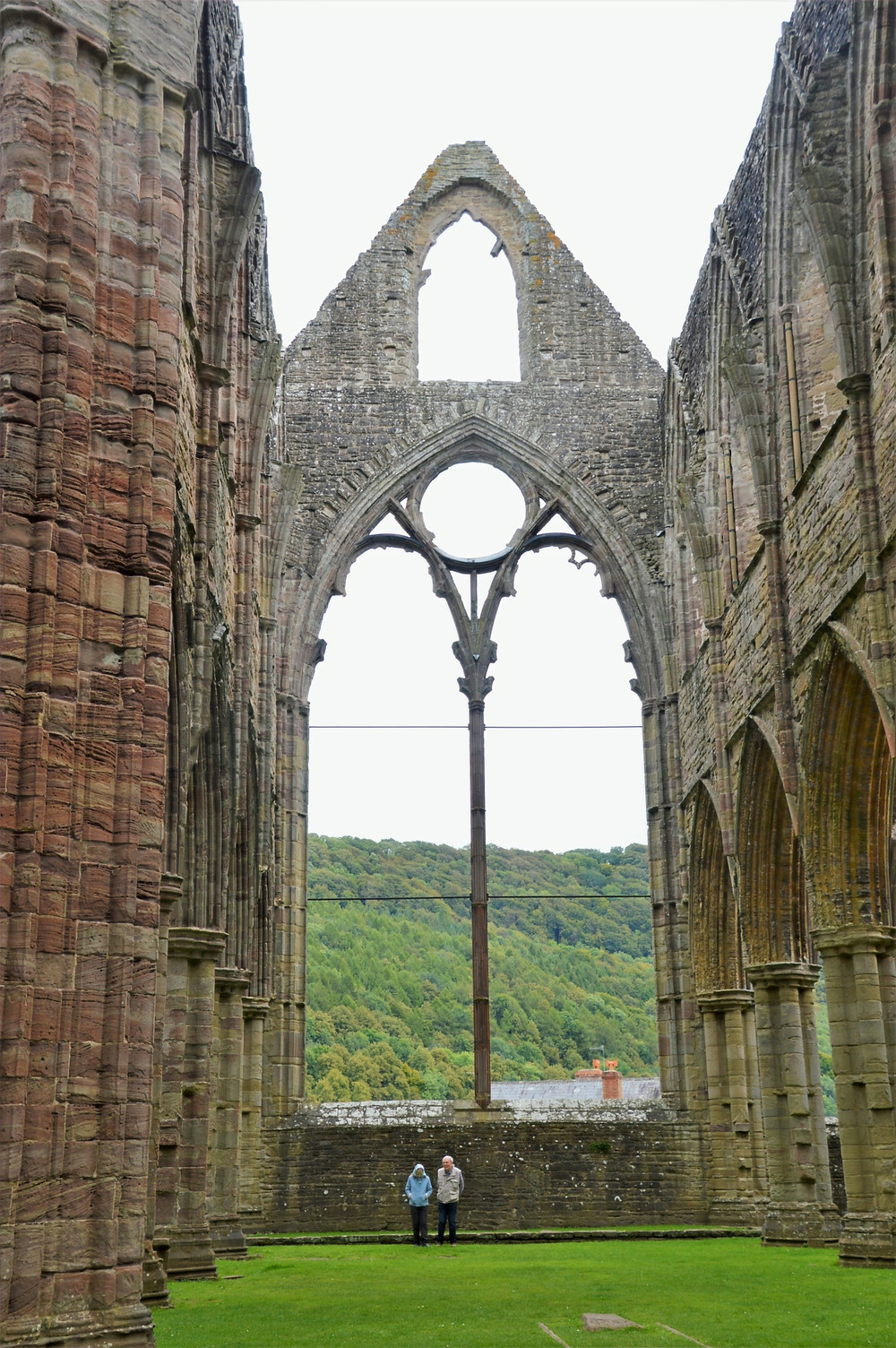 Ruins of the great window in the east end of Tintern Abbey in Southern Wales.  Slender central mullion and circular window from Tintern Abbey East Walls.