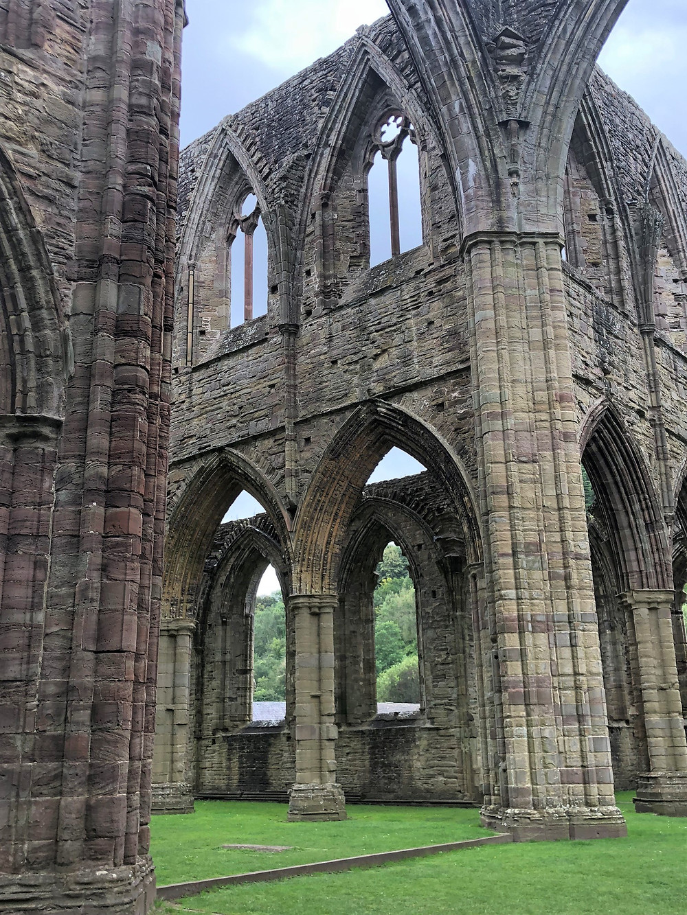 The intricate stonework on the pillars and arches in Tintern Abbey in Southern Wales