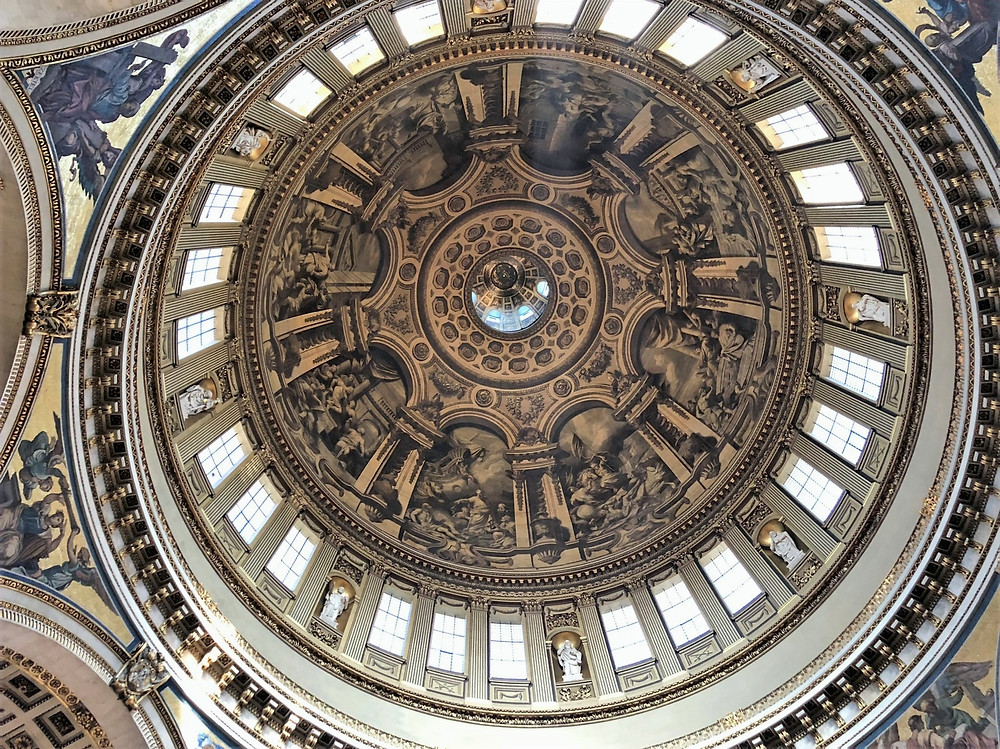 Looking up at the dome of St Paul's Cathedral in London. It took Sir Sir James Thornhill3 years to completed the paintings.