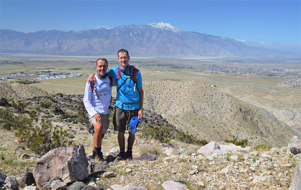 Standing on summit of Chocolate Drop Hill with San Jacinto in the background
