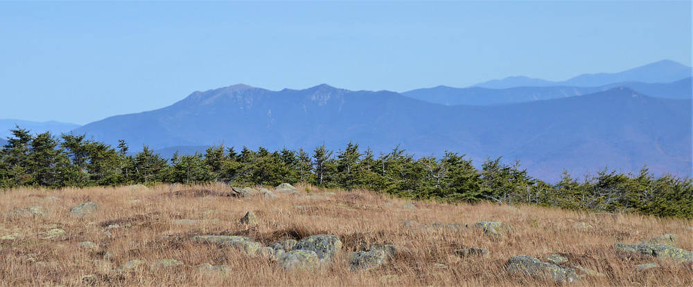 Franconia Range on the left and Mt Washington peak visible in the top far right. Summit of Mt