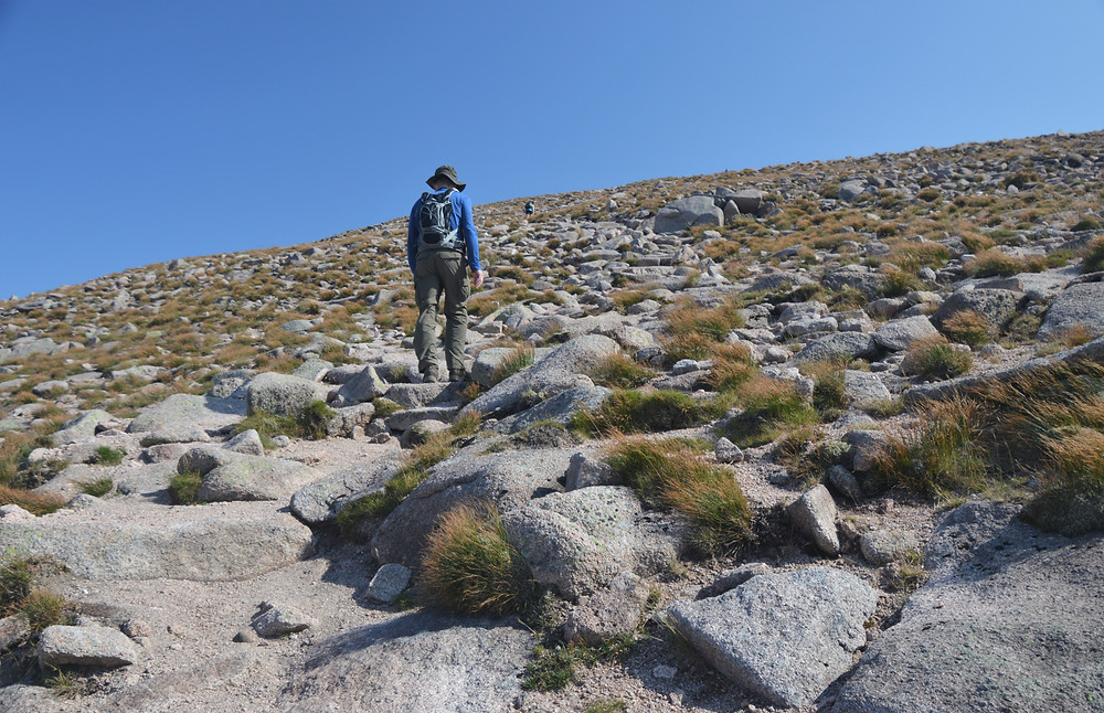 Making our way up Cairn Gorm summit on a  rock covered slope.