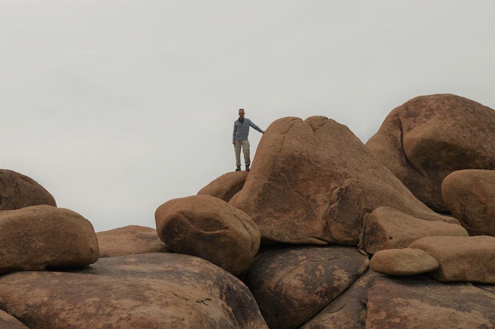 Climbing boulders on Mastadon Trail Loop in Joshua Tree National Park