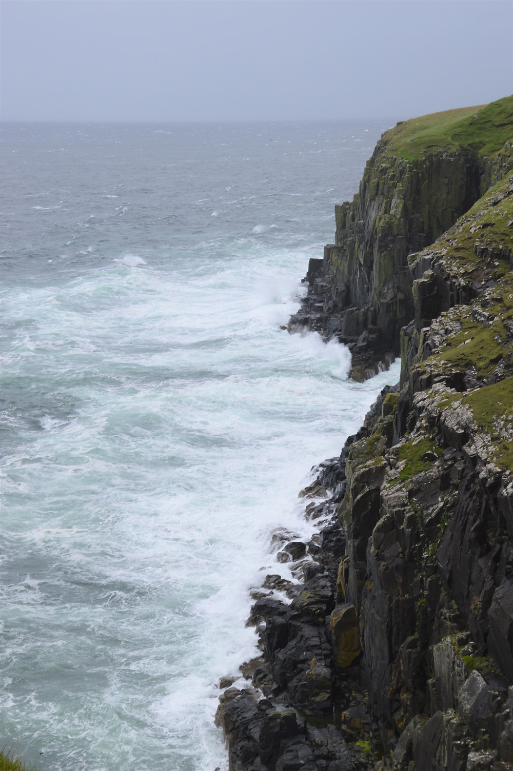 Storms battering the sea cliff of Neist Point on the Isle of Skye