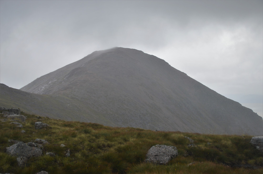 Approaching the base of Stob Na Doire in pouring rain. Clouds covering the summit of Stob Na Doire
