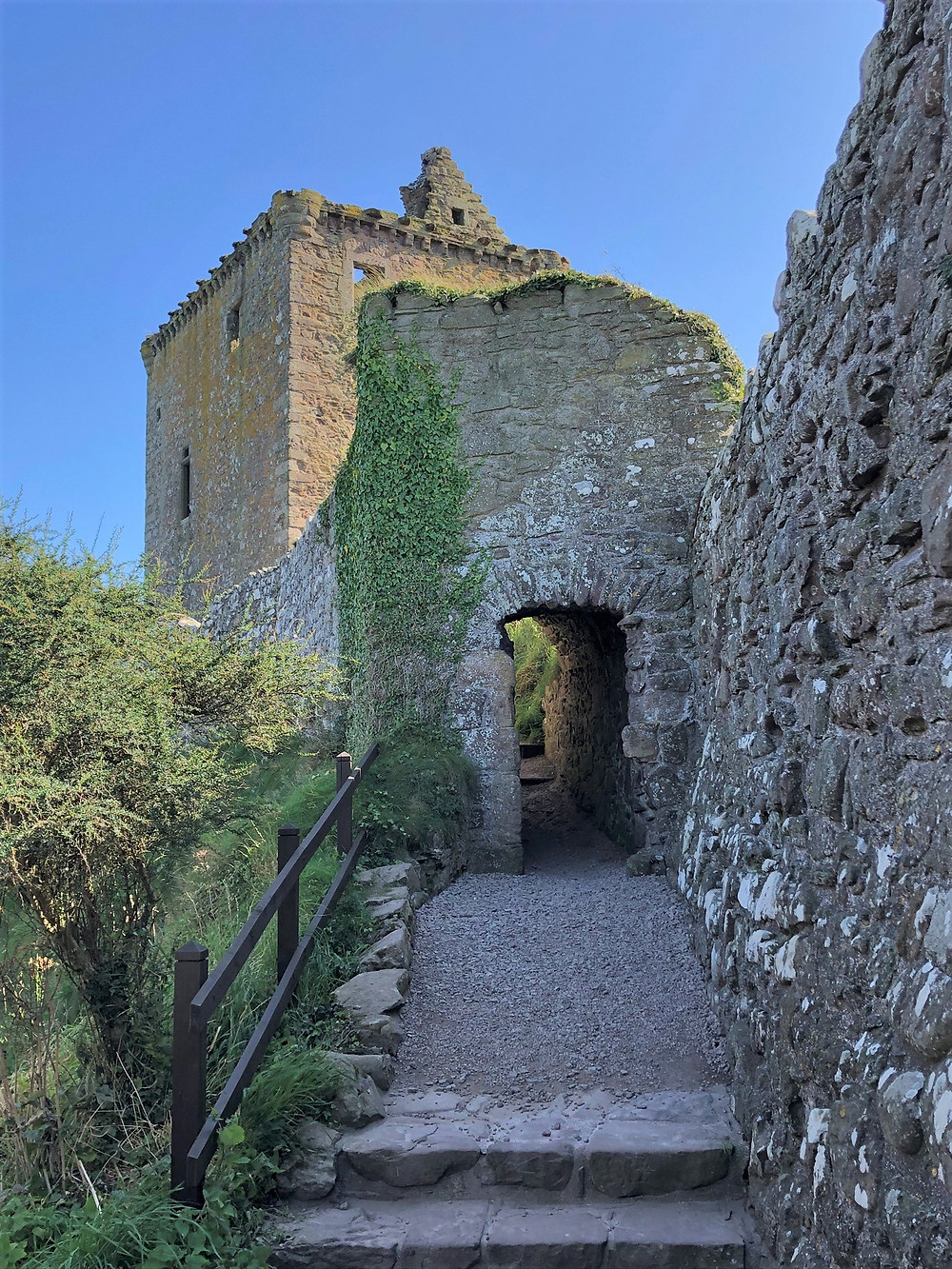 Exiting the Dunnottar Castle entrance with sweeping view of the complex