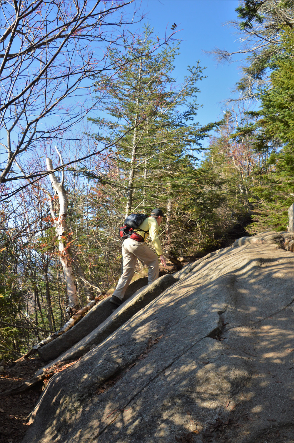 Climbing rock slab on Old Bridle Path to Mt Lafayette