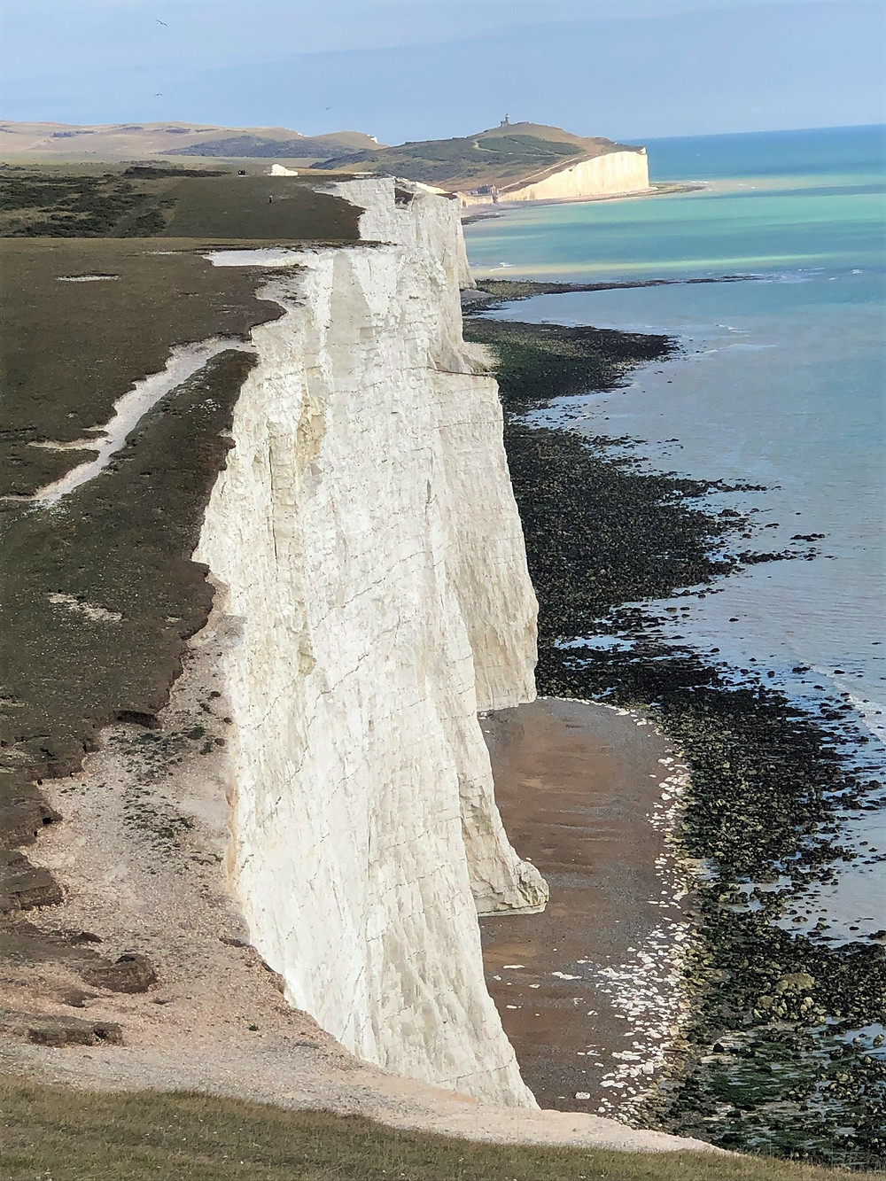 A view of Short Brow and Rough Brow from the top of Haven Brow one of the Seven Sisters Cliffs in England