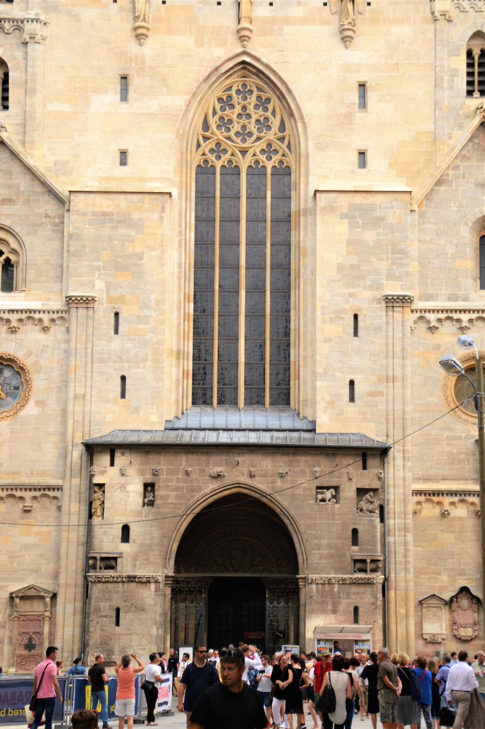The oldest remaining parts of St. Stephen's Cathedral is the 'Giant Gate' entrance and adjacent Roman towers date back to the early 1200s.