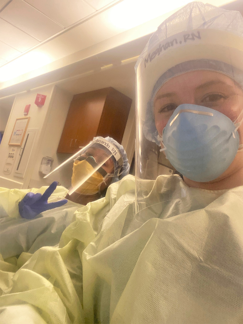Nurses wearing PPE in hospital during COVID pandemic
