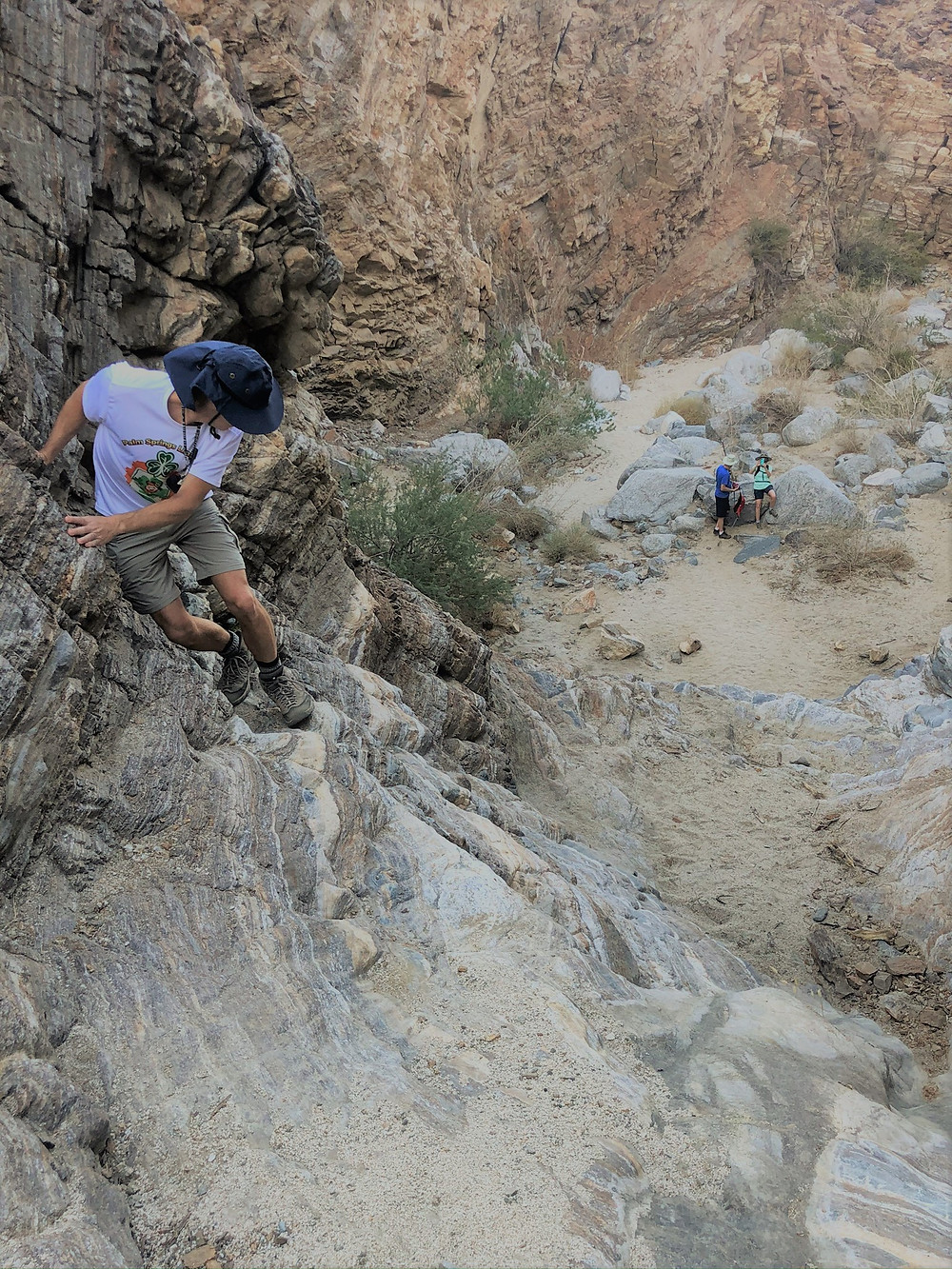 Scaling 30 foot rock ledge in Carrizzo Canyon in the Santa Rosa Mountains in Palm Desert CA