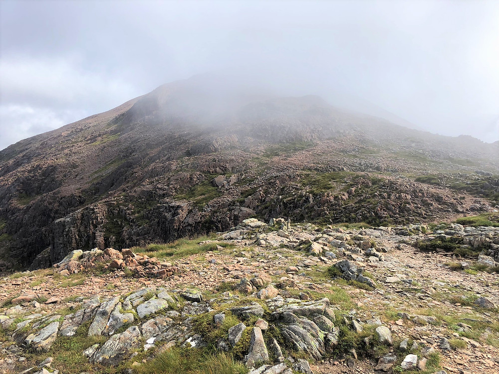 From the baelach the view of the summit of Stob Dearg Buachaille Etive Mòr in the Scottish Highlands was covered in clouds