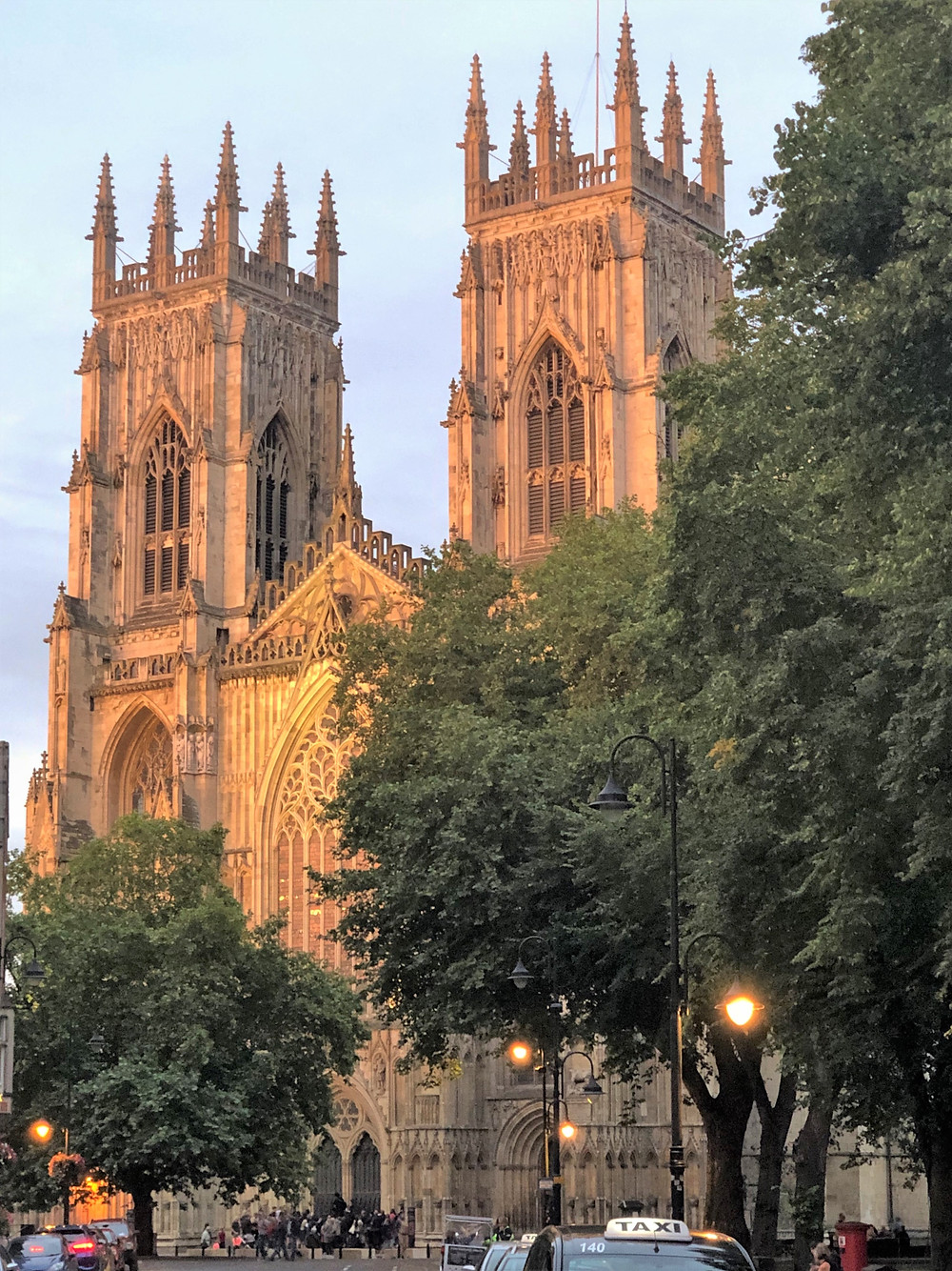 Work on York Minster started in 1220 and finished 1405. Sunset lighting up the towers of York Minster