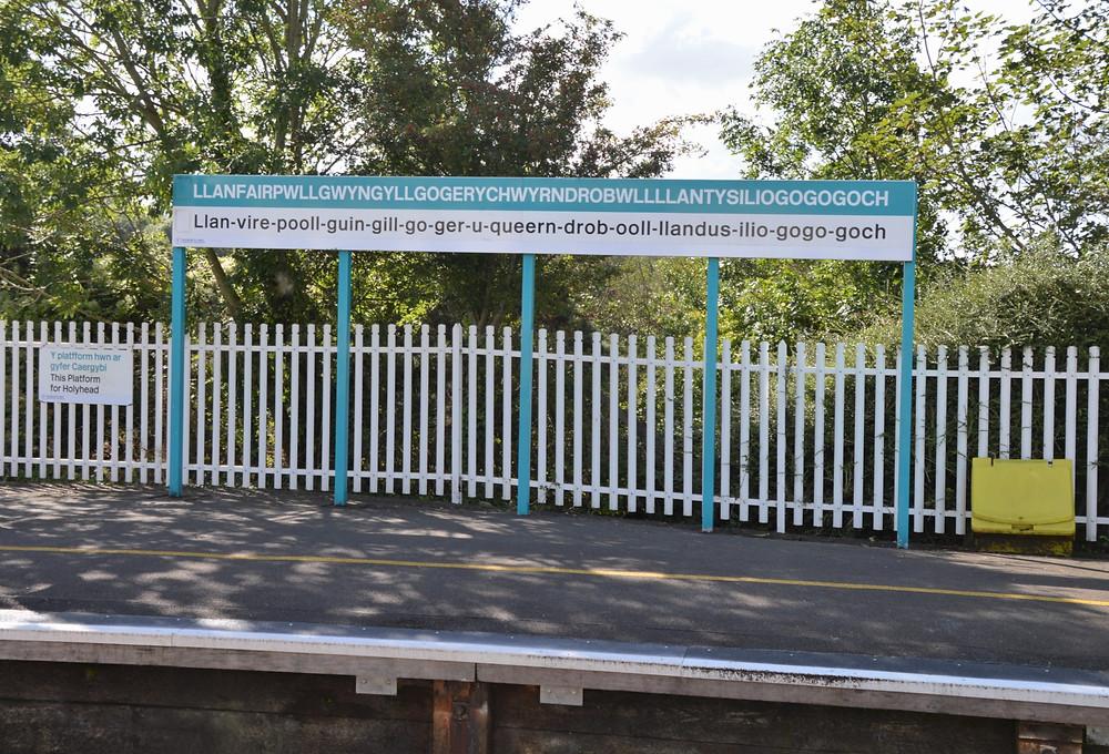LLanfairpwllgwyngyllgogerycuwyrndrobwllllantysiliogogogoch Train Station sign the longest place name in Europe