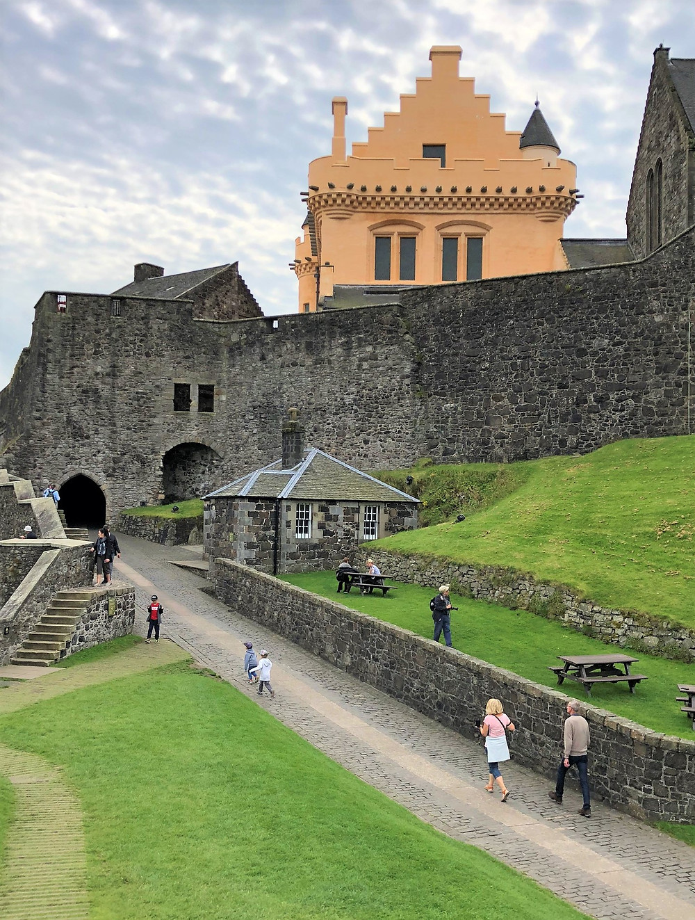 Stirling Castle North Gate was built around 1381 with the gold-colored Great Hall in the background