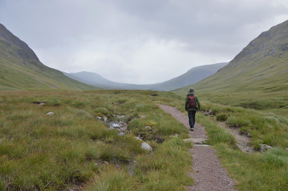 Walking along the Lairig Gartain pass in Etive Glen in Scottish Highlands