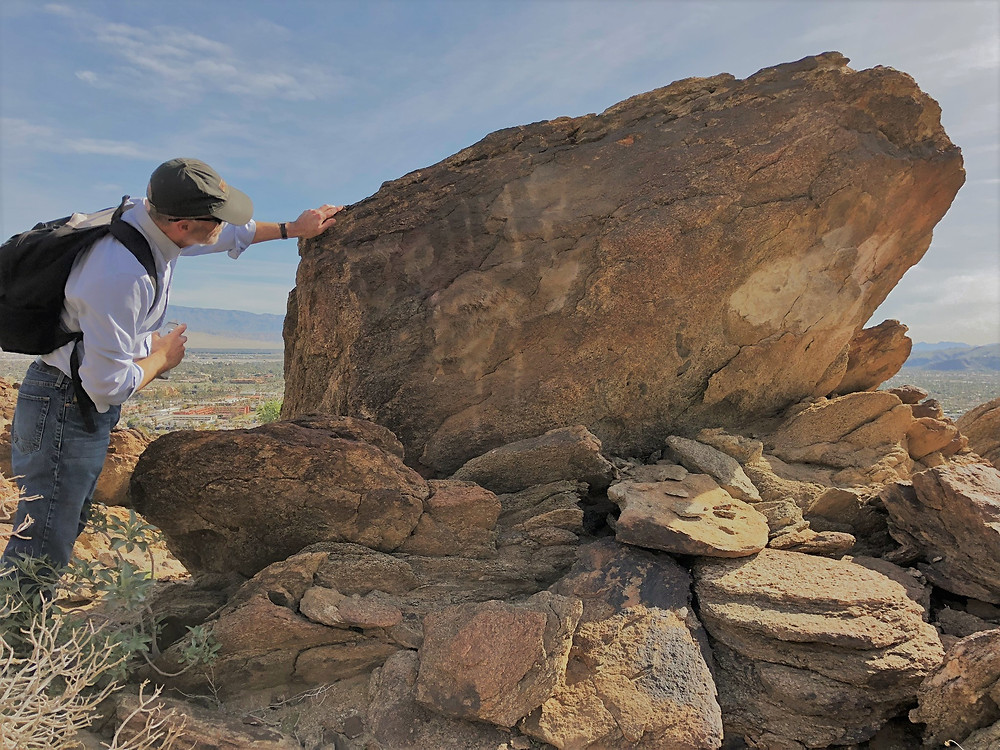 Efforts by Friends of the Desert Mountains organization to remove graffiti from local hiking trails.  After treatment photo