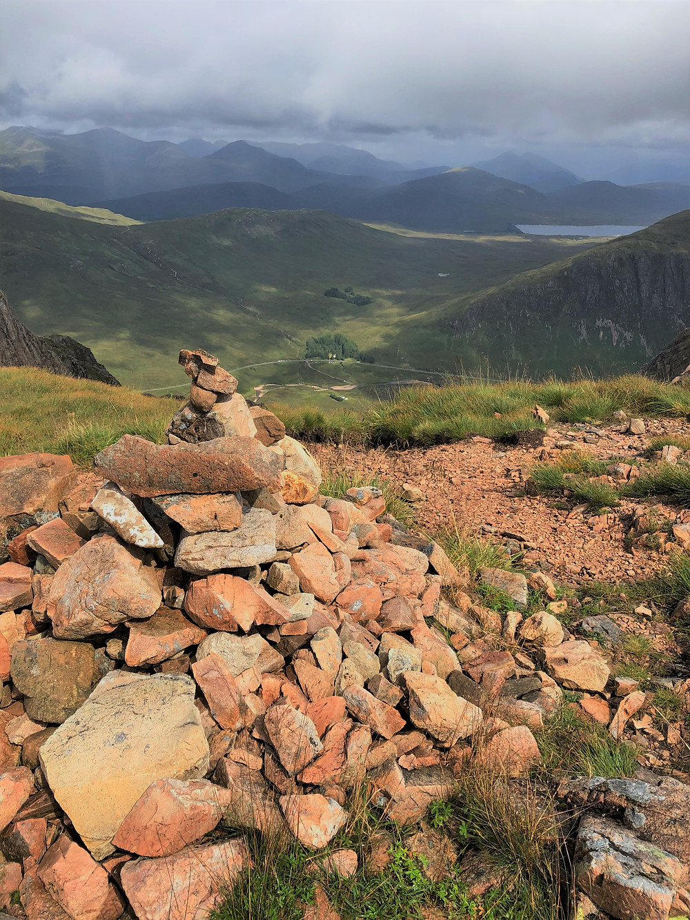 View of Scottish Highlands from the saddle or baelach at 2,850 ft on the climb to the summit of Buachaille Etive Mòr in the Scottish Highlands