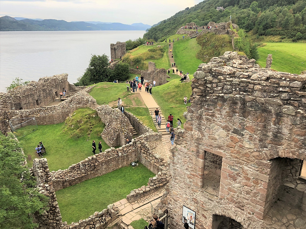 The huge footprint of Urquhart castle ruins spread out on the banks of Loch Ness.
