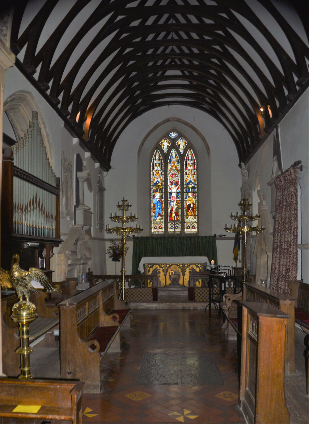 Interior and high altar of Church of St Peter's in Upper Slaughter of the Cotswolds
