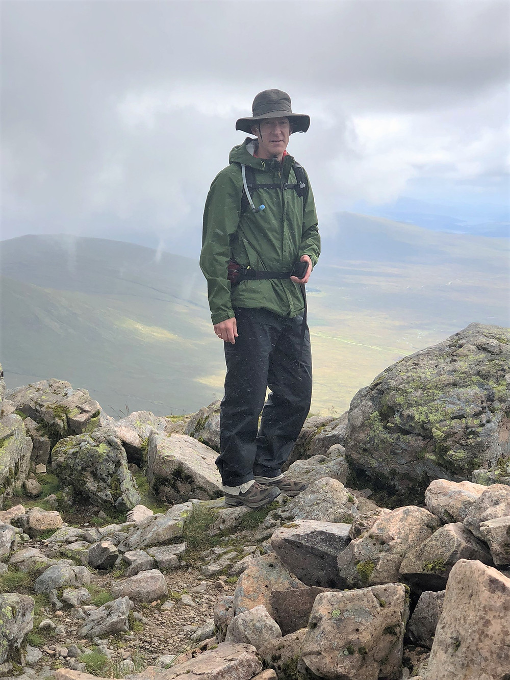 Stormy weather at the summit of Stob Dearg on Buachaille Etive Mòr in the Scottish Highlands