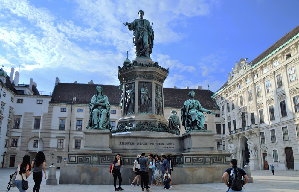 In the middle of the Inner Square of the Imperial Hofsburg Palace is a bronze statue of Francis I dressed as a Roman emperor.  Francis I was Holy Roman Emperor and wife of Empress Maria Theresa
