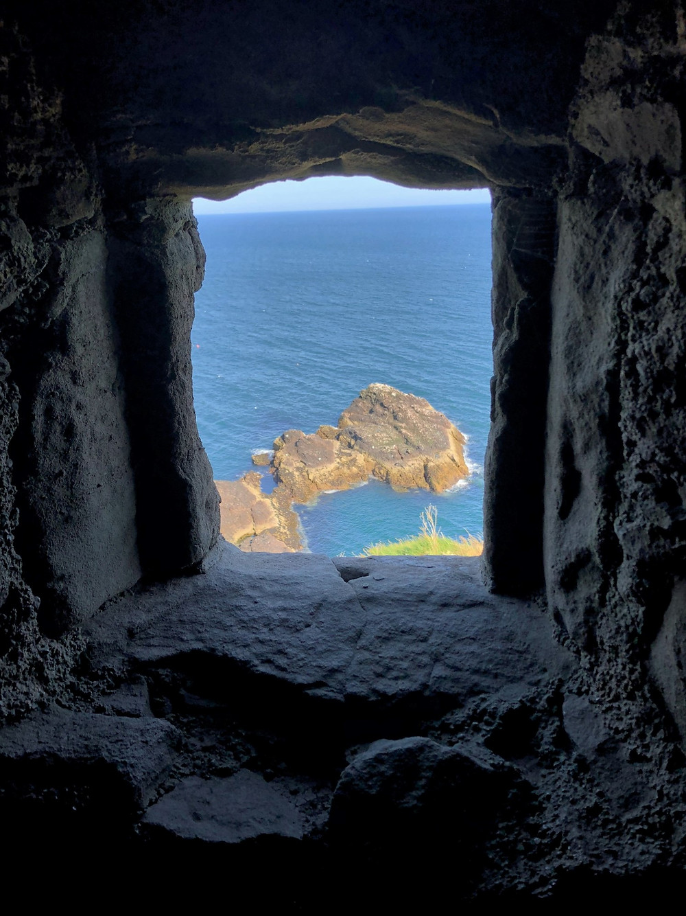 Dunnottar Castle fortress window opening looking at the North Sea