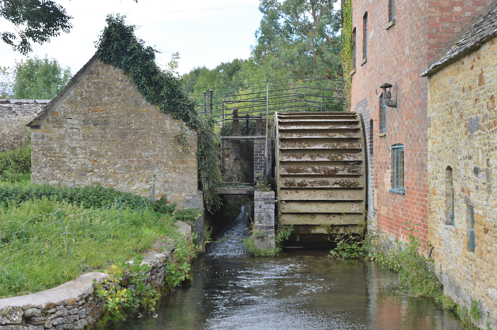 Waterwheel at the 19th century flour mill located along the River Eye in Lower Slaughter of the Cotswolds