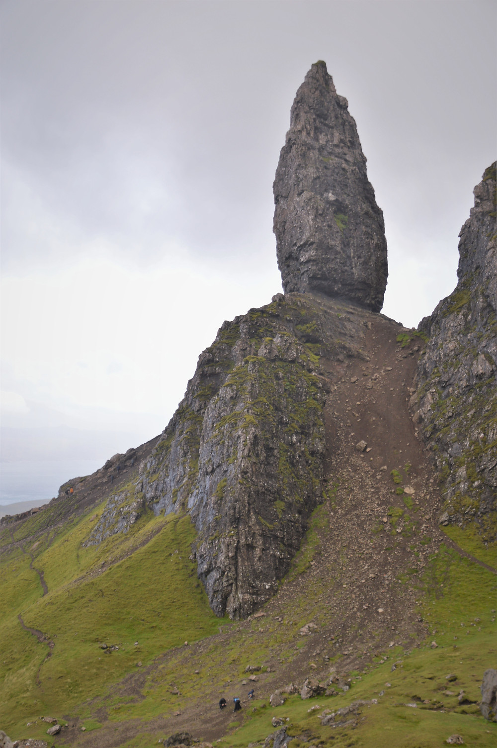 Rock Pinnacles on the Old Man of Storr are remnants of ancient volcano plus. Rock pinnacles tower over hikers on the trail. Isle of Skye