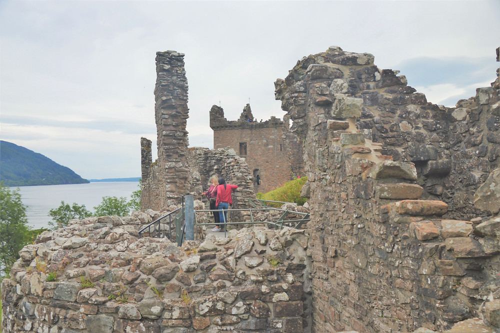 Urquhart Castle ruins with decaying walls and buildings.
