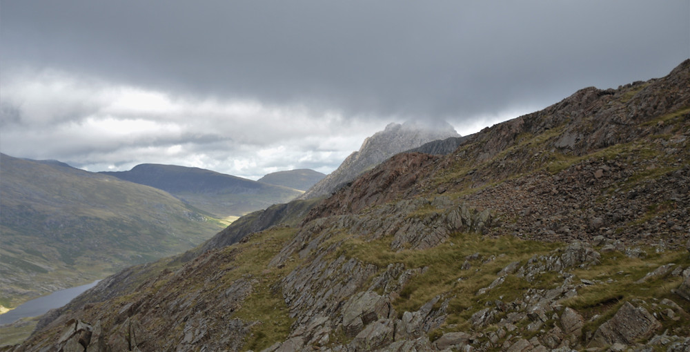 Tryfan's summit piercing the cloud cover viewed from Devil's Kitchen in Snowdonia