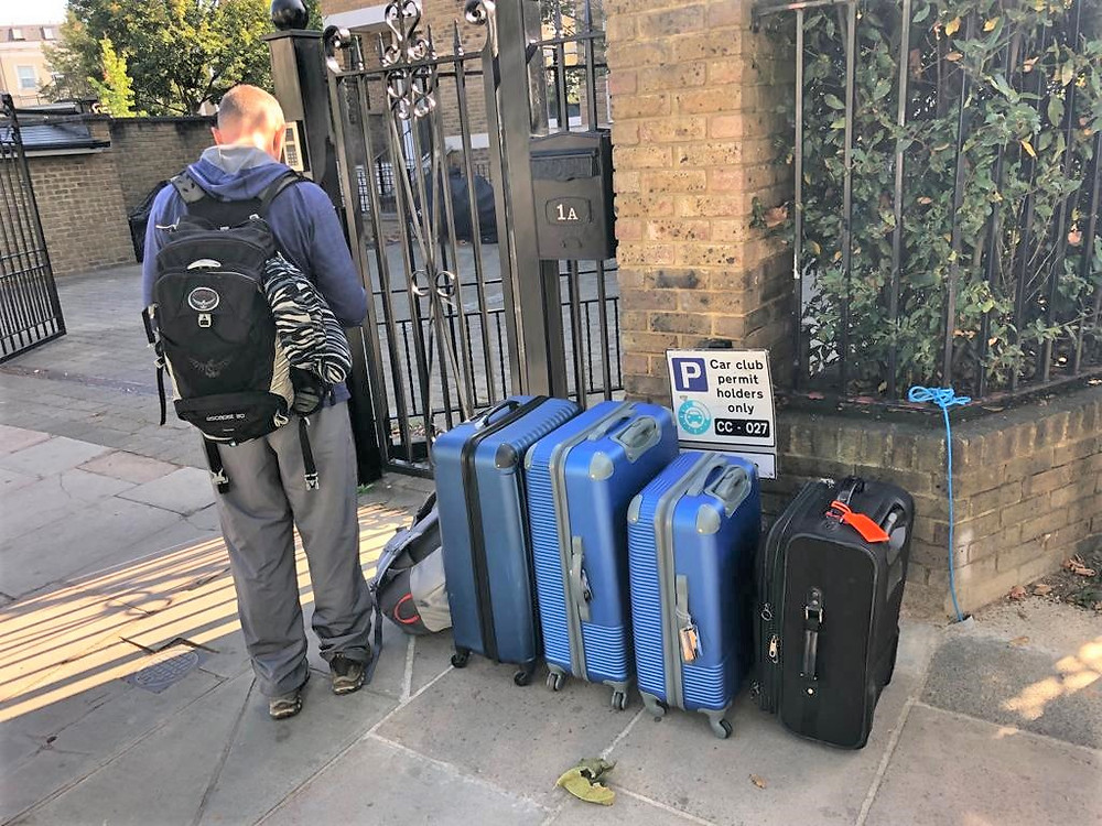 Suitcases packed waiting for Uber to take us to Heathrow Airport after 6 weeks traveling through Great Britain