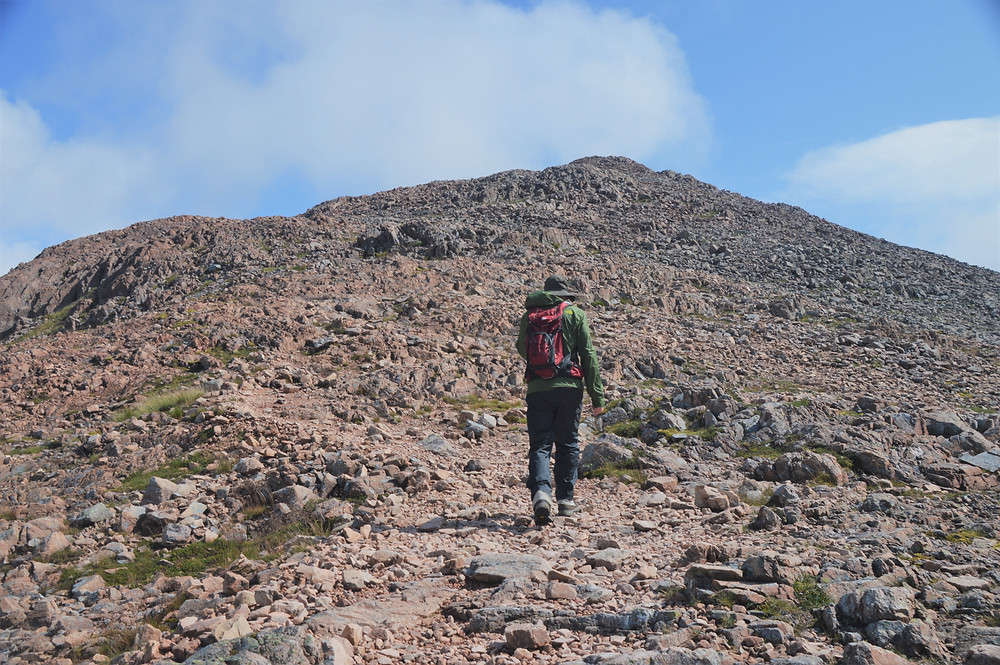 Nearing the rocky summit of Stob Dearg on Buachaille Etive Mòr in the Scottish Highlands