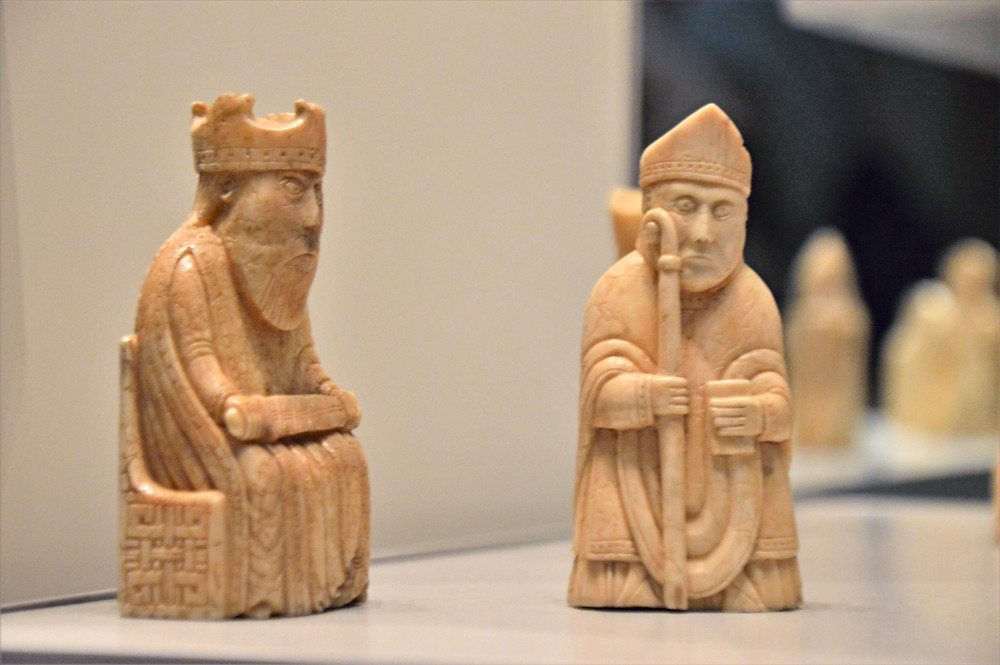 On display in the British Museum the Lewis Chessmen a King in a throne and Bishop holding a mitre and bible