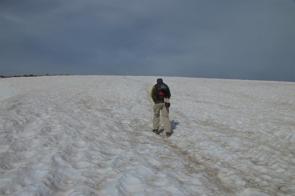 Crossing snowfield on hike to Hallett Peak in Rocky Mountain National Park