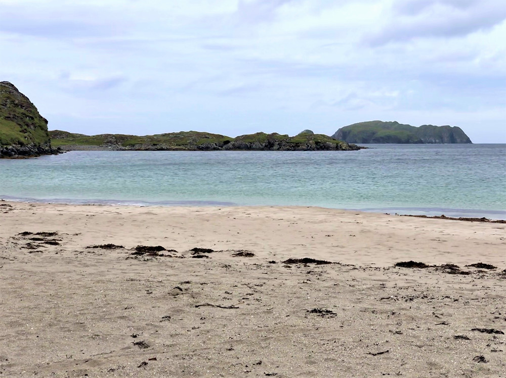 Enjoying the secluded beach of Traigh Bostadh on Great Bernera Loop trail in the Outer Hebrides