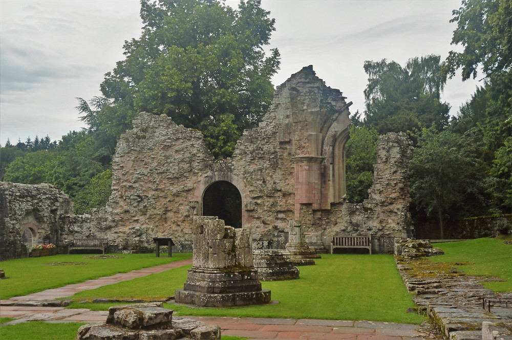 Crumbling stone walls of Dryburgh Abbey in the Broder Region of Southern Scotland